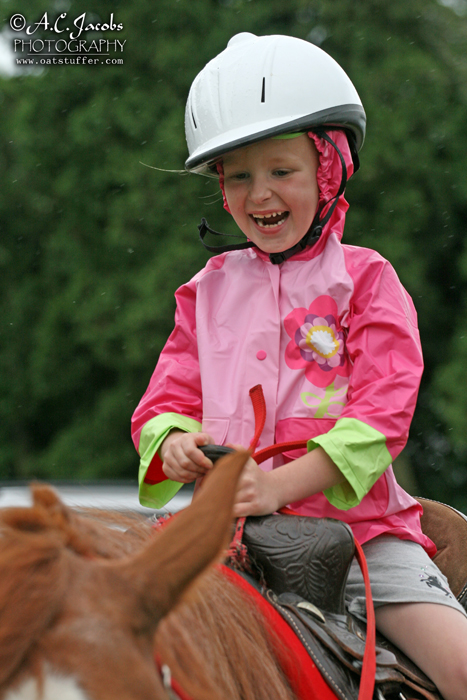 Girl Giddy on a Horse